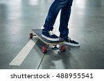 Close Up Of Skater On Longboard