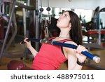fitness time. muscular woman... | Shutterstock . vector #488975011