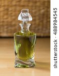 Small photo of Green absinth in the glass carafe on wooden background
