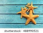 Starfish On Blue Wooden...