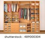 wooden wardrobe closet full of... | Shutterstock . vector #489000304