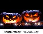 halloween pumpkin and  candle... | Shutterstock . vector #489003829