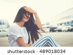 woman seated on curb has her... | Shutterstock . vector #489018034