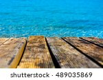 Small photo of Natural wooden deck at the blue sea. Aegean Sea.