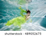 smiling young woman in yellow... | Shutterstock . vector #489052675