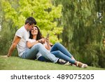 young couple using smartphone... | Shutterstock . vector #489075205