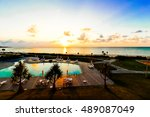 a beach and a pool and sunset... | Shutterstock . vector #489087049