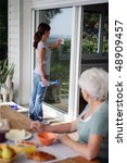 senior woman with home help | Shutterstock . vector #48909457