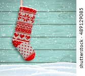 knitted christmas stocking with ... | Shutterstock .eps vector #489129085