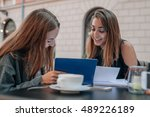 two female students are... | Shutterstock . vector #489226189