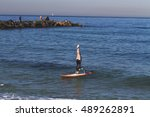 Headstand On A Surfboard In...