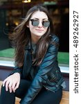 pretty girl in a black leather... | Shutterstock . vector #489262927