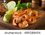 Delicious sauteed shrimp with cajun seasoning and lime on a maple plank.