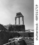 Small photo of The Temple of Castor and Pollux in the Roman Forum, near the Colosseum, in Rome, Italy, Three Corinthian columns left from the original Octastyle temple. Black and white image.