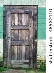 old doors with green bricks as background - stock photo