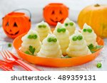 mashed potatoes ghosts with... | Shutterstock . vector #489359131