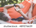 the girl lying in a hammock ... | Shutterstock . vector #489376639