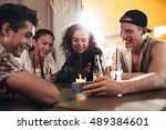 cheerful young friends looking... | Shutterstock . vector #489384601