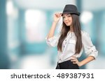 beautiful young woman wearing... | Shutterstock . vector #489387931