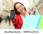 front view of a shopper holding ... | Shutterstock . vector #489412411