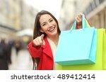 Happy Shopper Wearing Red Coat...