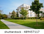 New apartment building - modern residential development in a green urban settlement - stock photo