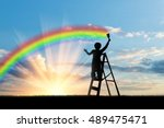 child paints a rainbow in the... | Shutterstock . vector #489475471