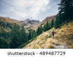 girl hikes on the italian alps   Shutterstock . vector #489487729