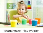 cute little child girl painting ... | Shutterstock . vector #489490189