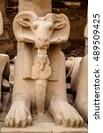 Small photo of Ram-headed sphinx, symbol of egyptian god Amun Ra, having statue of pharaoh Ramesses II between its paws, Karnak Temple, Luxor, Egypt