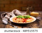 plate of pasta with tomato... | Shutterstock . vector #489515575