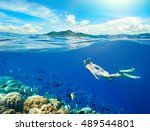 woman swims around a coral reef ... | Shutterstock . vector #489544801