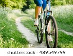 a girl riding a bicycle near a...   Shutterstock . vector #489549799