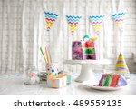 sliced colorful cake on festive ... | Shutterstock . vector #489559135