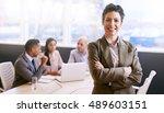confident businesswoman smiling ... | Shutterstock . vector #489603151
