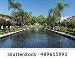 Small photo of YORBA LINDA, CALIFORNIA - AUGUST 4: Reflecting pool and boyhood home at the Richard Nixon Library & Birthplace on August 4, 2016 in Yorba Linda, California