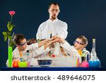 happy kids with scientist doing ... | Shutterstock . vector #489646075