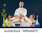 happy kids with scientist doing ... | Shutterstock . vector #489646075