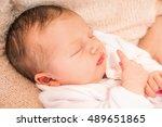 newborn baby girl sleeping... | Shutterstock . vector #489651865