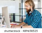 young man working in office | Shutterstock . vector #489658525