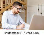 young man architect in office | Shutterstock . vector #489664201