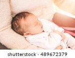 closeup of newborn baby girl in ... | Shutterstock . vector #489672379