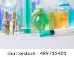 syringe with ampules of drugs | Shutterstock . vector #489713401