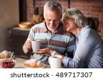 happy old couple having coffee... | Shutterstock . vector #489717307