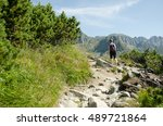 Young girl on turist trial in mountains. - stock photo