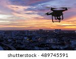 silhouette of drone flying... | Shutterstock . vector #489745591