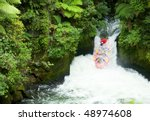 A group of whitewater rafters on the Kaituna River, New Zealand - stock photo