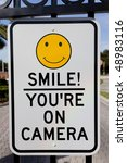 A Smile You're On Camera Sign...