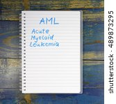 Small photo of AML - Acute Myeloid Leukemia diagnosis written in notebook