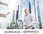 portrait of running businessman | Shutterstock . vector #489949315